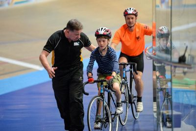 Coach and student at the derby velodrome
